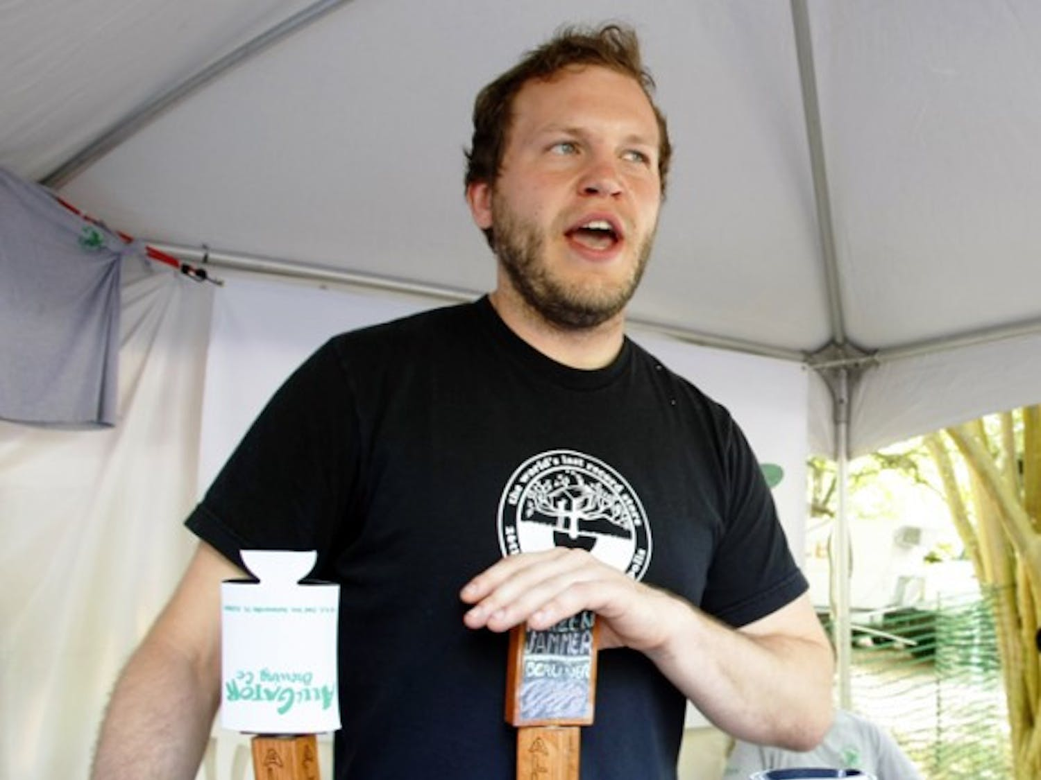 Neal Mackowiak, brewer at Alligator Brewing Co., serves samples at the Hogtown Craft Beer Festival on Saturday.