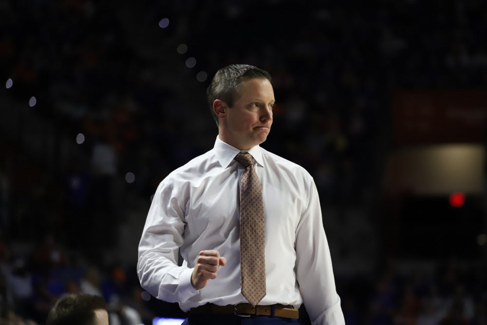 <p>Head coach Mike White court side at the UF-Marshal game last season. He will prepare his team for its first game in nearly two weeks against No. 24 Arkansas</p>