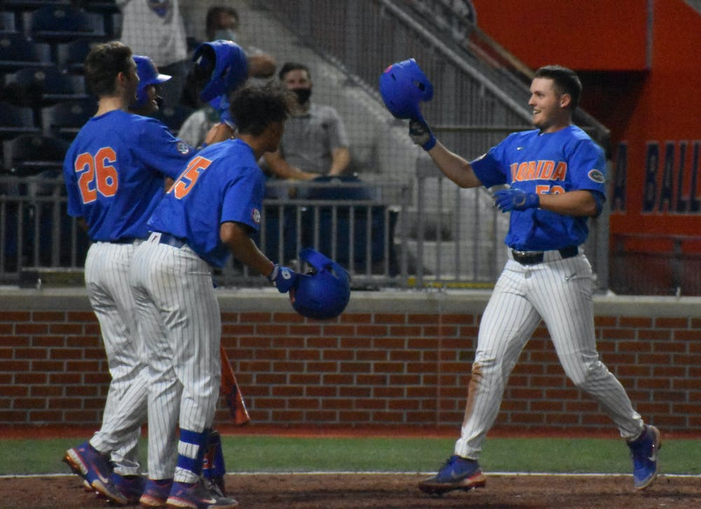 Kirby McMullen (52) celebrates with teammates after he hit a home run against Jacksonville March 13.