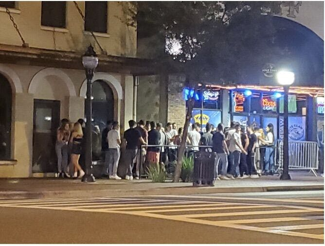 Photo of a crowd outside of Downtown Fats