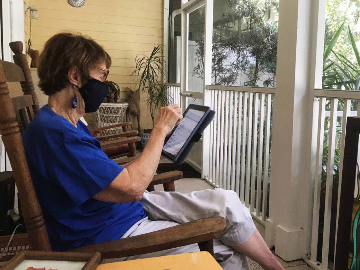 Patsy Nelms, an 83-year-old resident of Oak Hammock, is seen using her iPad on her back porch Sunday, Oct. 11, 2020. Patsy occasionally invites friends to sit on her porch and share her homemade, frosty peppermint ice cream — a Patsy Nelms staple, which she offers within minutes of entering her home.