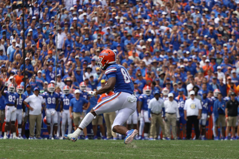 Pitts is in the running against Ole Miss wide receiver Elijah Moore and Alabama wide receiver DeVonta Smith. Photo from UF-Tennessee game in September 2019.