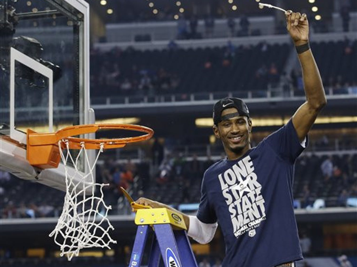 Connecticut guard Lasan Kromah cuts down the net after beating Kentucky 60-54 at the NCAA Tournament championship game Monday in Arlington, Texas.