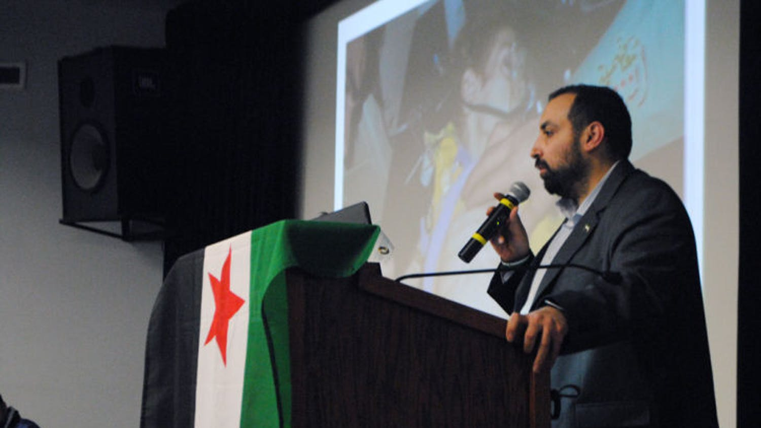 Mohamad Khir Alwazir speaks of his experience as a survivor of a chemical weapons attack in Syria. The Arabic Cultural Association at UF and UF Amnesty International hosted the event Monday evening.