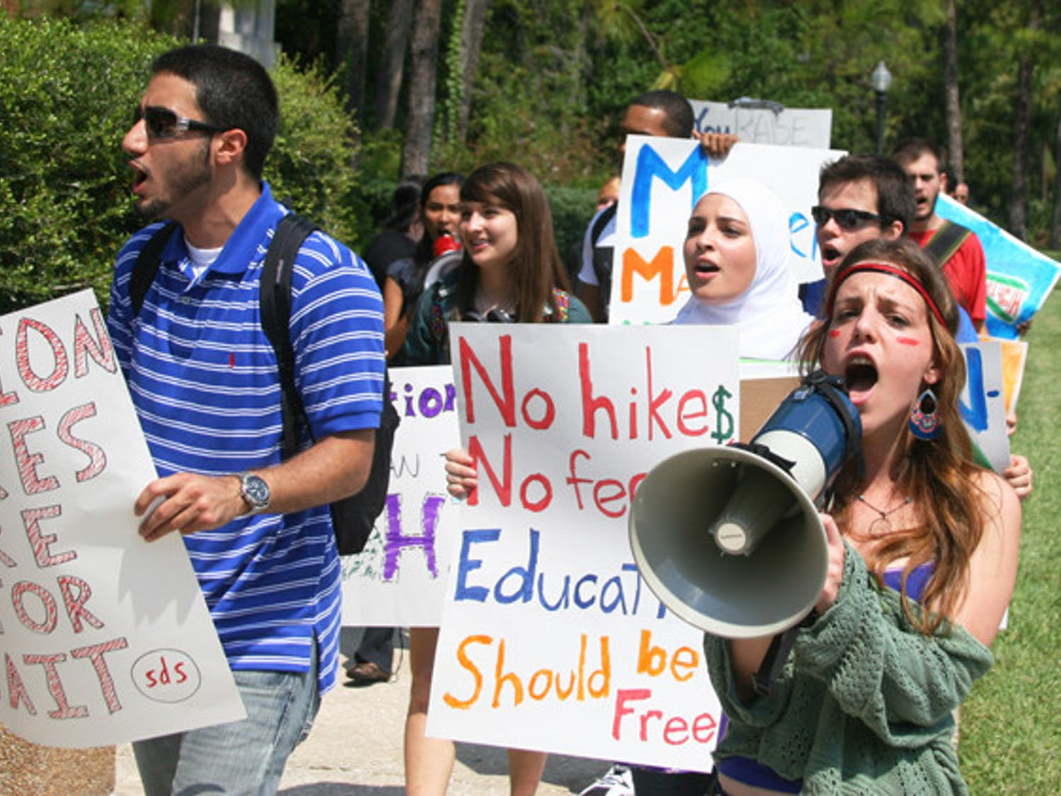 Members of Students for a Democratic Society protest tuition hikes around UF's campus Friday afternoon.