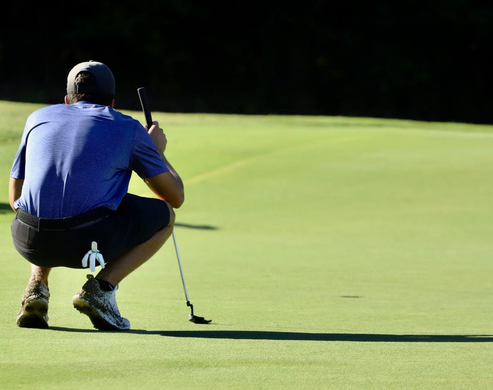 <p>Redshirt sophomore Fred Biondi stares down a hole while practicing at Mark Bostick Golf Course. Biondi led the Gators at Vanderbilt, finishing 15th individually.</p>