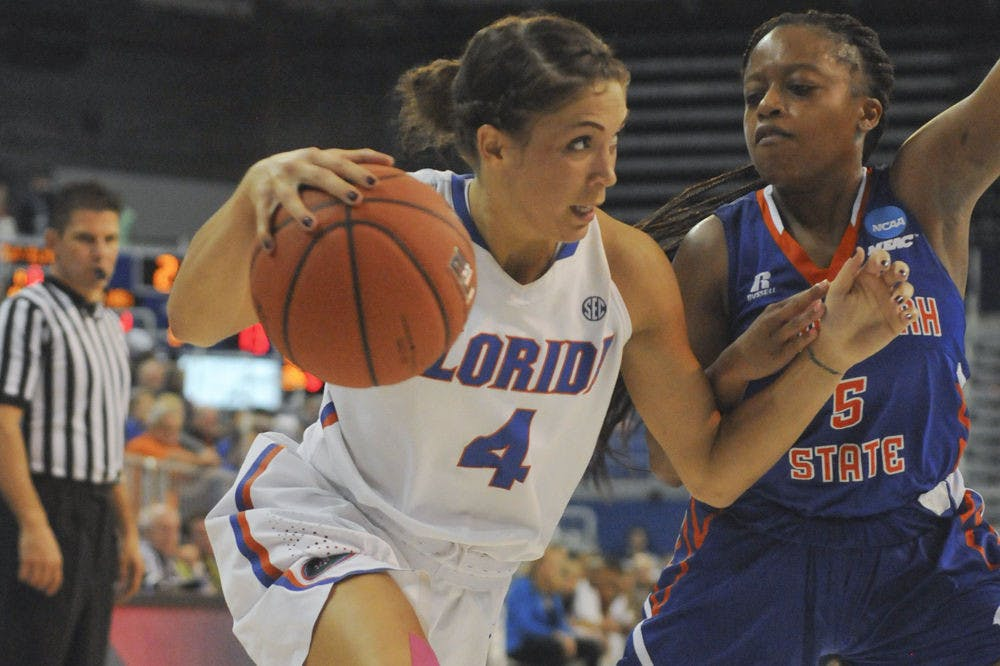 <p>UF point guard Carlie Needles drives to the basket during Florida's 99-34 win over Savannah State on Nov. 24, 2015, in the O'Connell Center.</p>