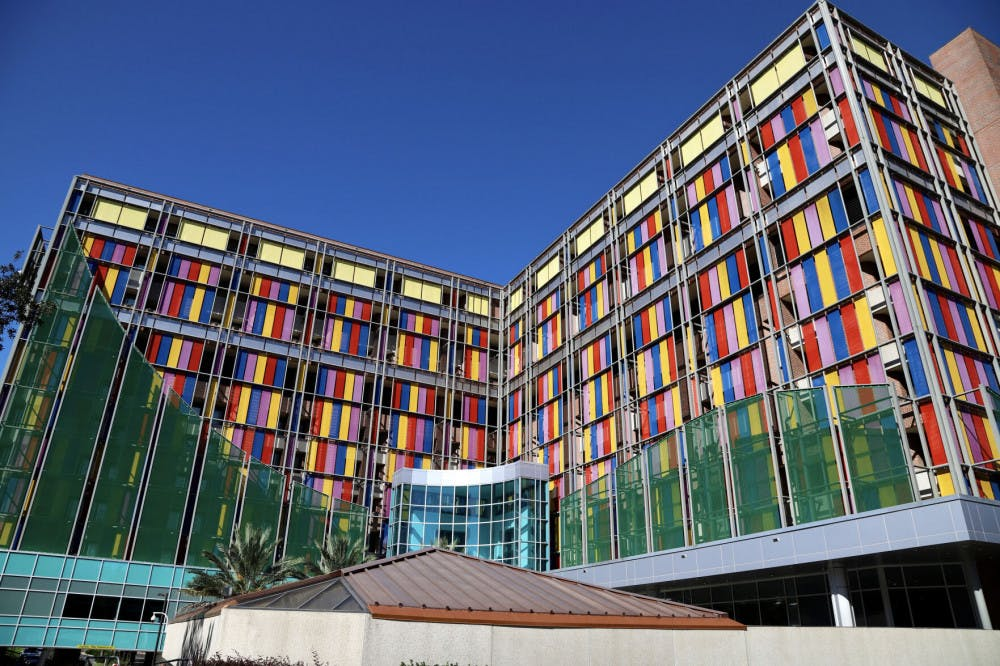 The multi-colored glass of the UF Health Shands Children's Hospital shines as the sunreflects off the panes on September 25, 2020. The pediatric staff provide care in more than 20specialties including pediatric hematology-oncology.