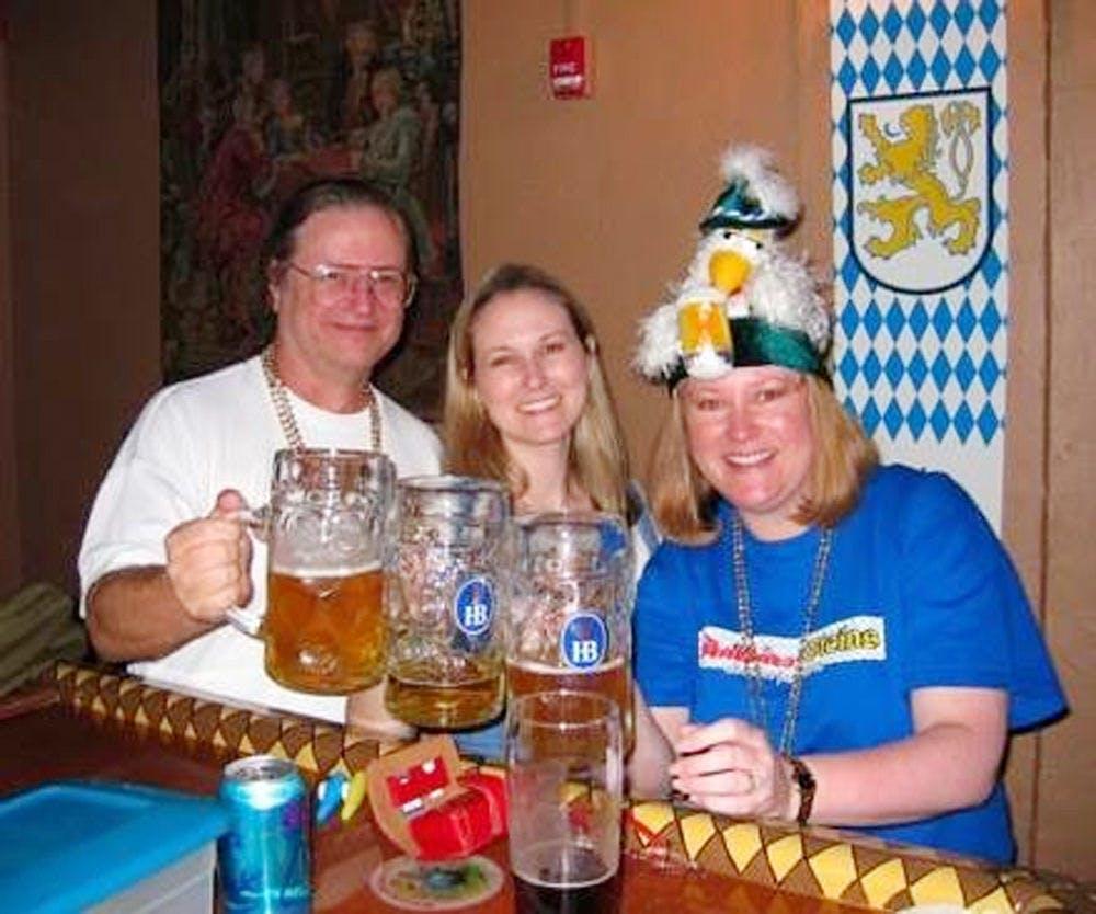 "<p class=""p1"">Owners Berkeley Hoflund (center) and her late father, Gar Hoflund, celebrate their first Oktoberfest at Stubbies &amp; Steins pub with Berkeley's older sister, Bryce Hoflund, in 2008.</p>"