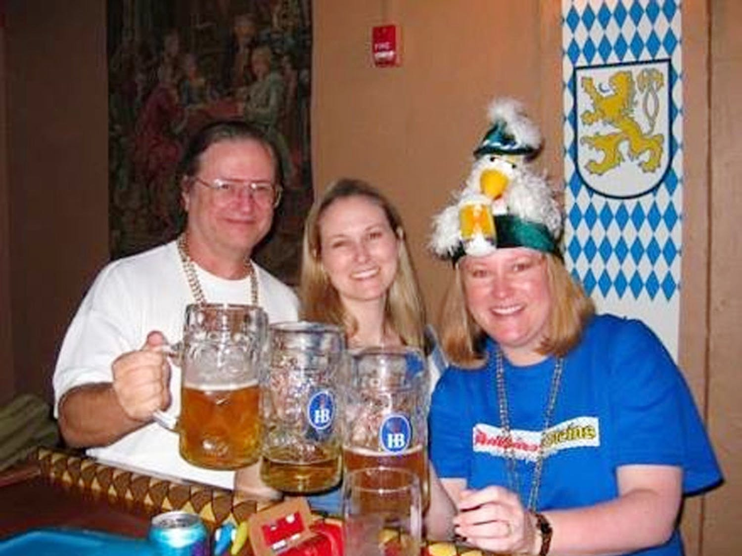 Owners Berkeley Hoflund (center) and her late father, Gar Hoflund, celebrate their first Oktoberfest at Stubbies & Steins pub with Berkeley's older sister, Bryce Hoflund, in 2008.