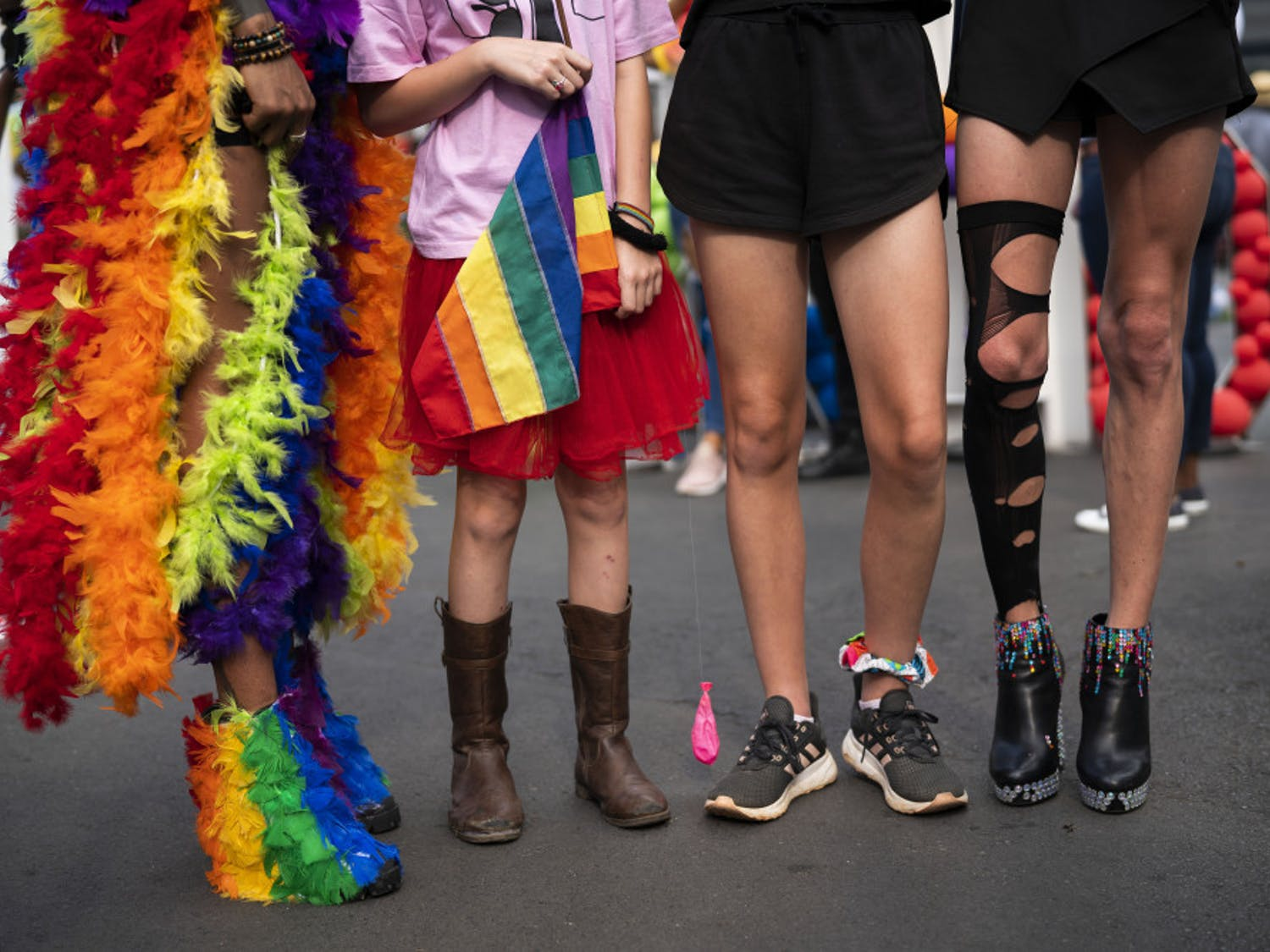 The legs of costumed people participating in the annual Gay Pride event in Johannesburg, South Africa, Saturday Oct. 26, 2019. Thousands took part in this 30th edition of the Gay Pride. (AP Photo/Jerome Delay)