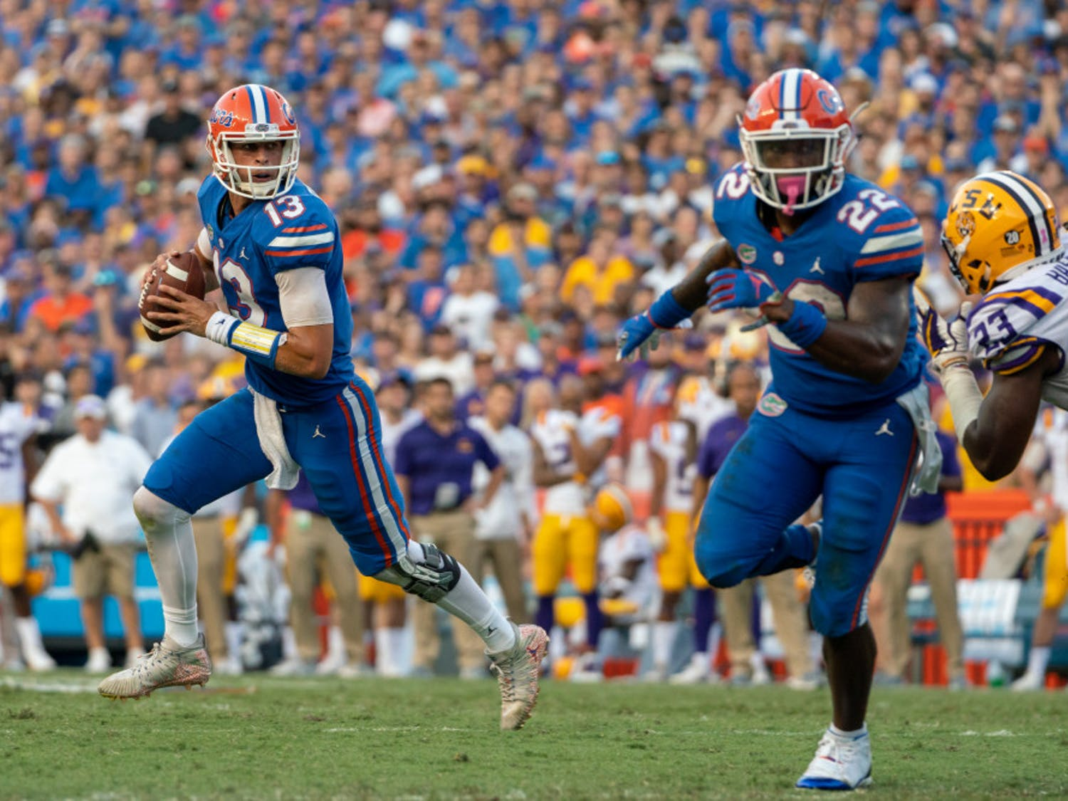 """Quarterback Feleipe Franks (13) said the Gators are still working on fundamentals in practice. """"You can't get complacent,"""" he said."""