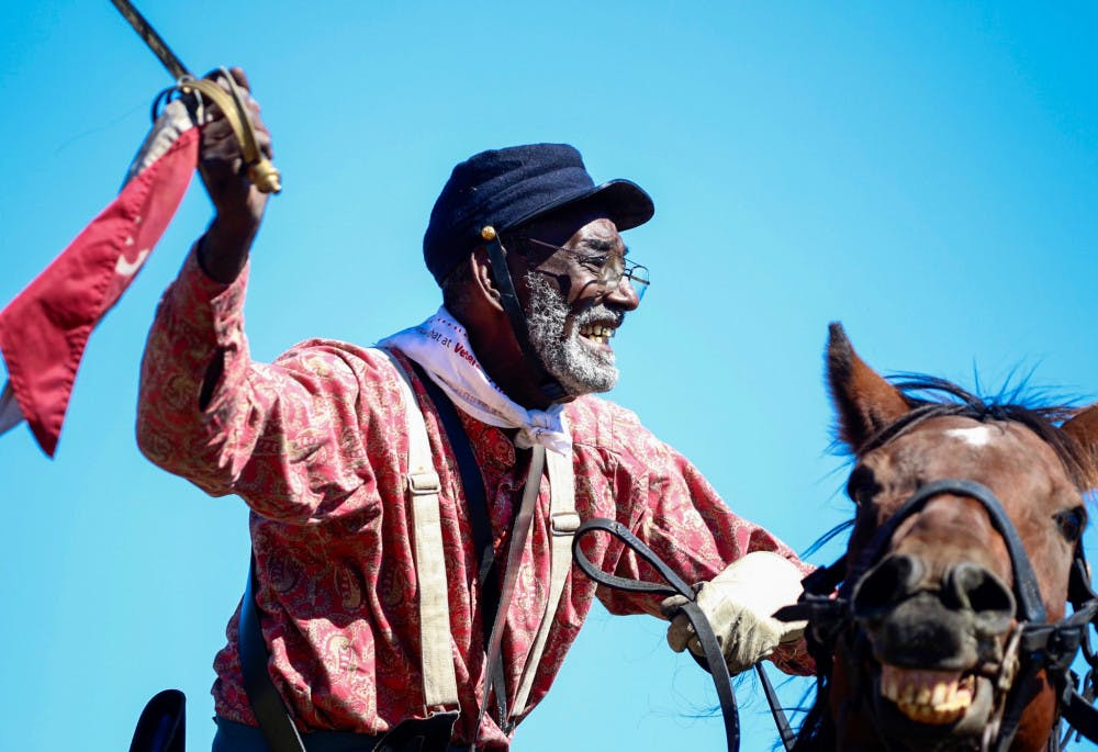 """<p dir=""""ltr"""">Civil War re-enactor and Vietnam War veteran Walter Anderson, 69, rides his horse, Sonney Boy, during the re-enactment. """"History, don't get it twisted,"""" Anderson said atop his horse after acting as a cavalry member for the Confederate side. """"That's why I do what I do, so history can get untwisted.""""</p>"""