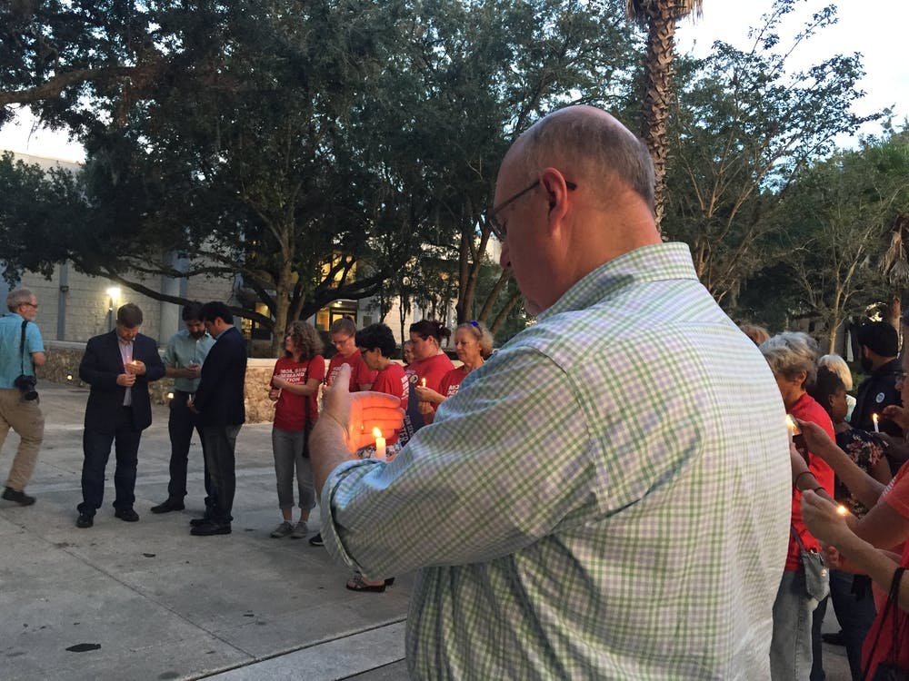 <p>About 50 Gainesville residents and elected officials gathered to honor the victims of Sunday's mass shooting in Jacksonville</p>