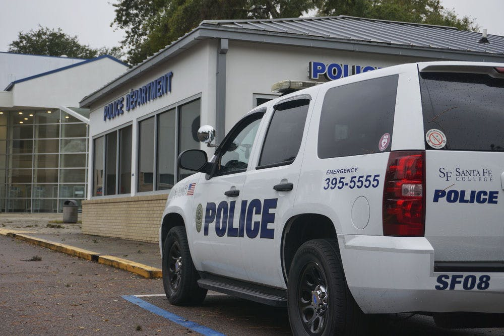 """<p class=""""p1"""">A police vehicle sits outside the Santa Fe Police Station on Monday, Nov. 18, 2014.&nbsp;</p>"""