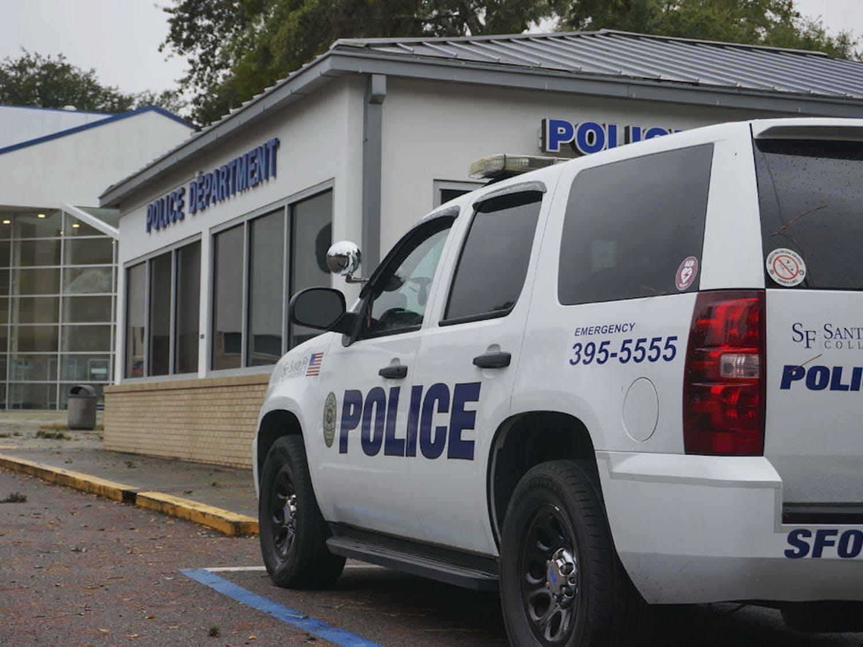 A police vehicle sits outside the Santa Fe Police Station on Monday, Nov. 18, 2014.
