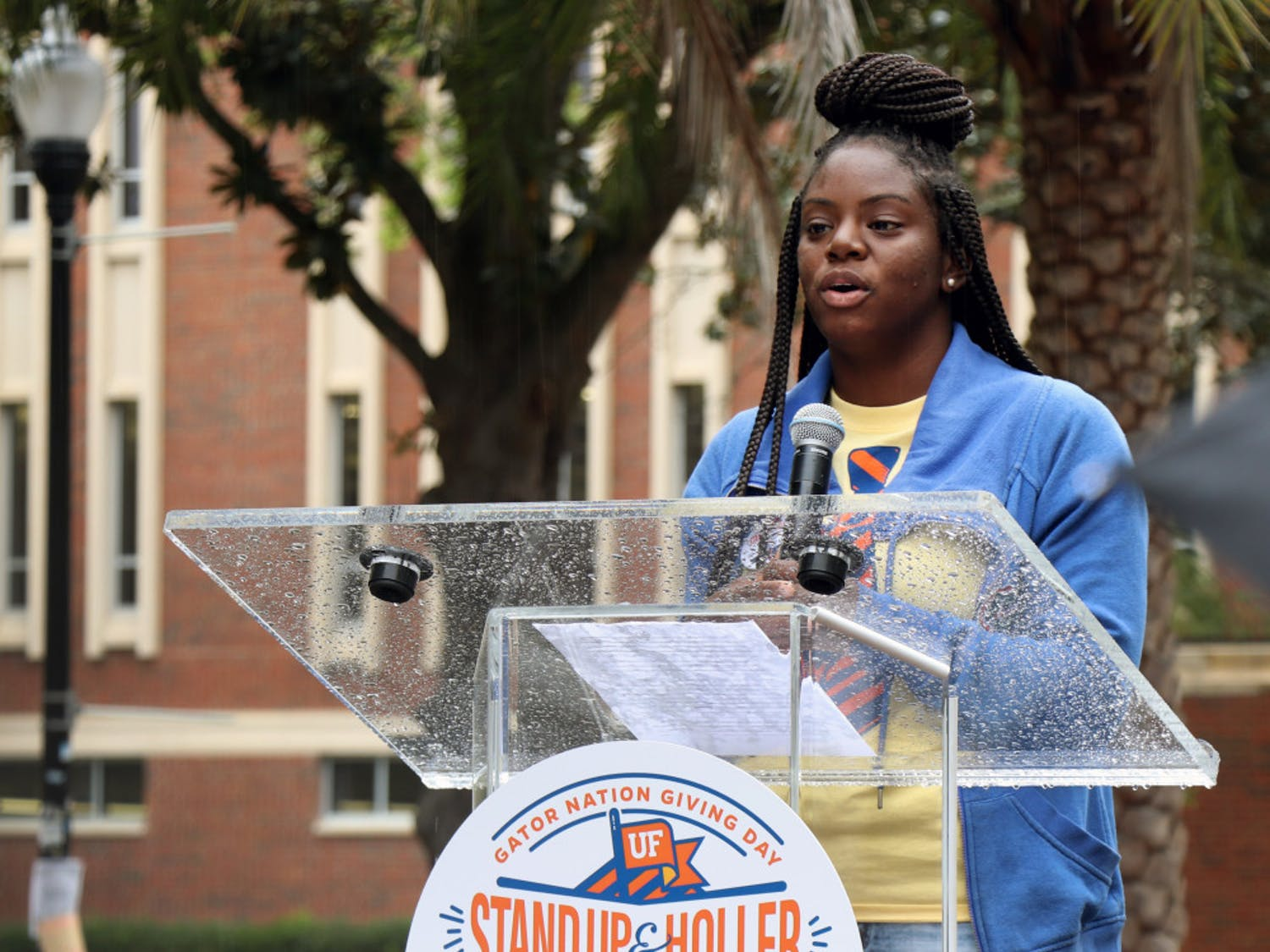 """Akiya Parks, a first-generation student and Machen Florida Opportunity Scholar, addresses the crowd on the Plaza of the Americas Feb. 26, 2019, for the """"Stand Up and Holler: Gator Nation Giving Day."""""""
