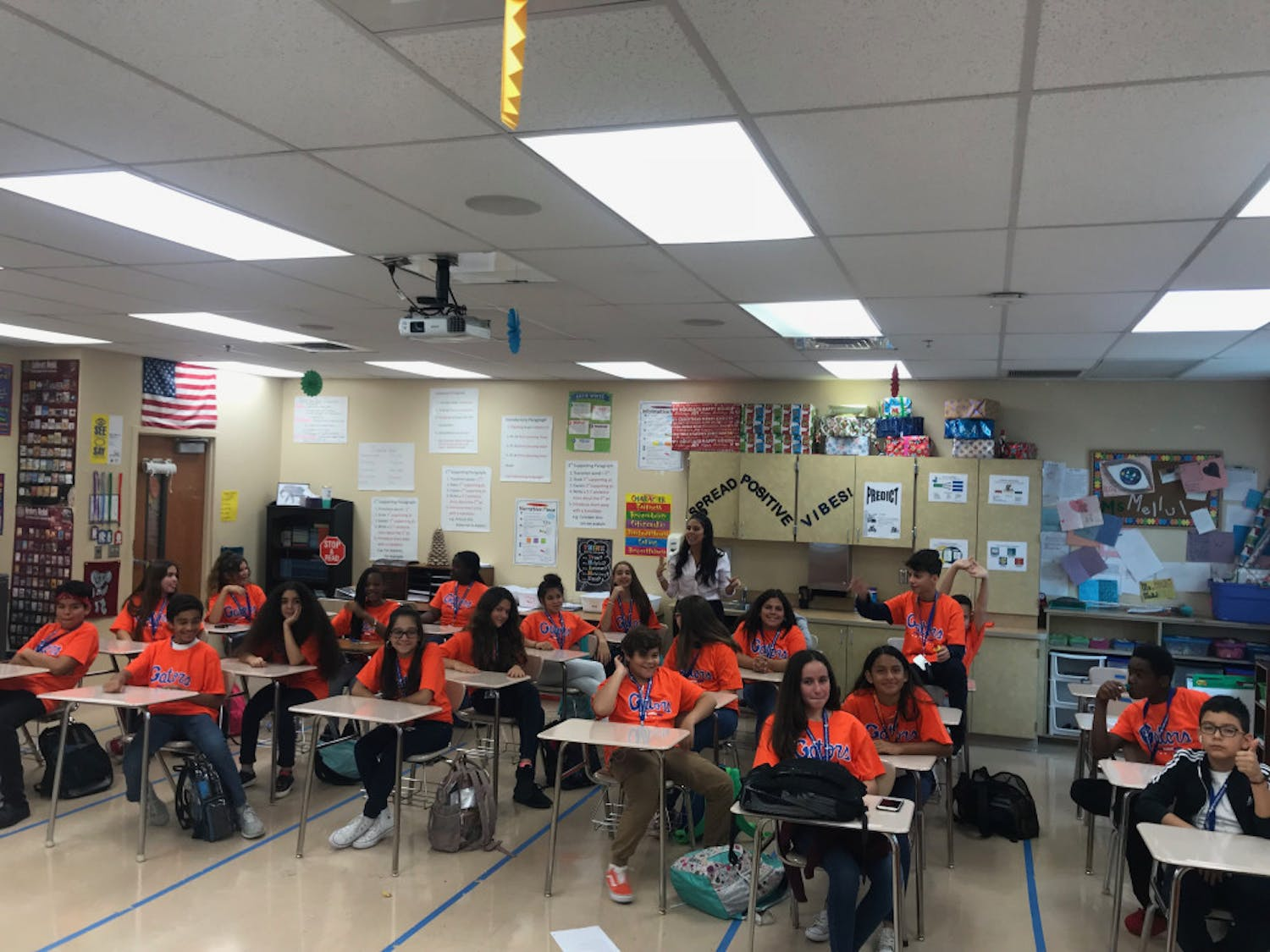 Students in their homeroom class at Palm Springs Community Middle School in West Palm Beach smile after receiving a box full of Gator shirts. UF was the only school of 20 to respond to the students request for shirts to celebrate College Friday.