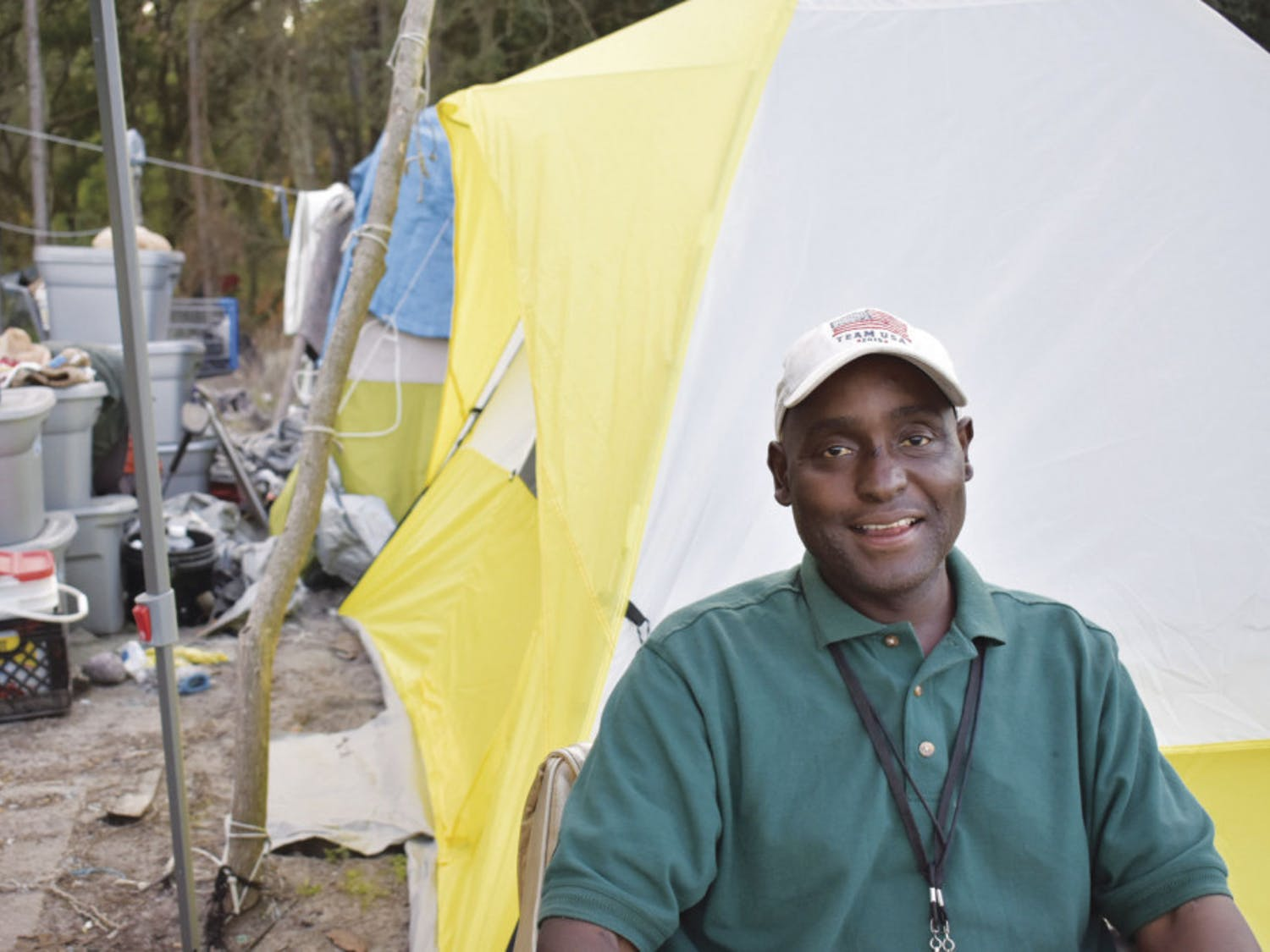 Heard smiles in front of his new tent, donated earlier this month by UF Christian Campus House.