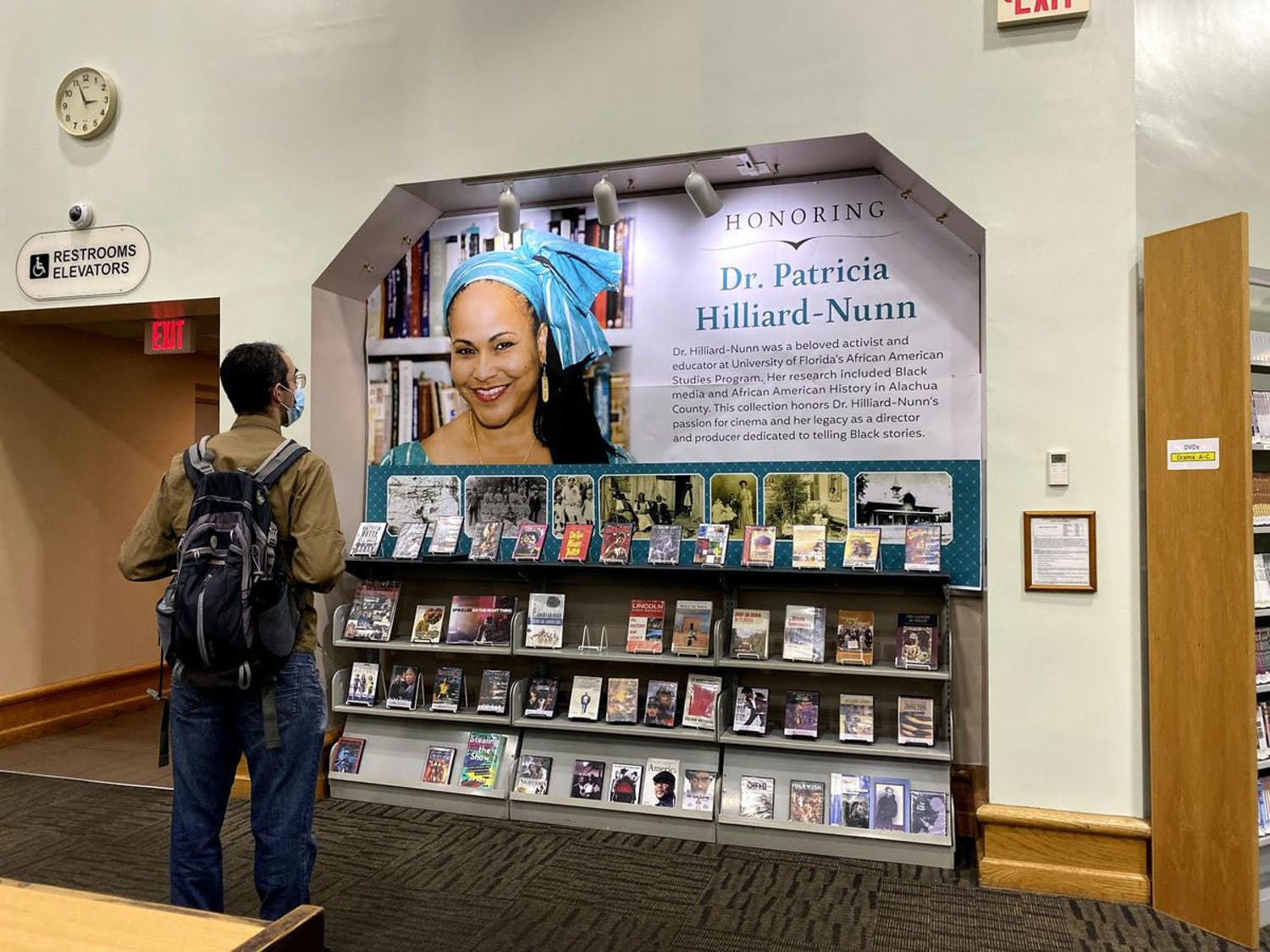 A man observes the collection of movies and books on the display honoring the late Patricia Hilliard-Nunn at the Headquarters Library. Hilliard-Nunn was an activist and adjunct associate professor at UF in the African American Studies Program who died on Aug. 5 at 57.