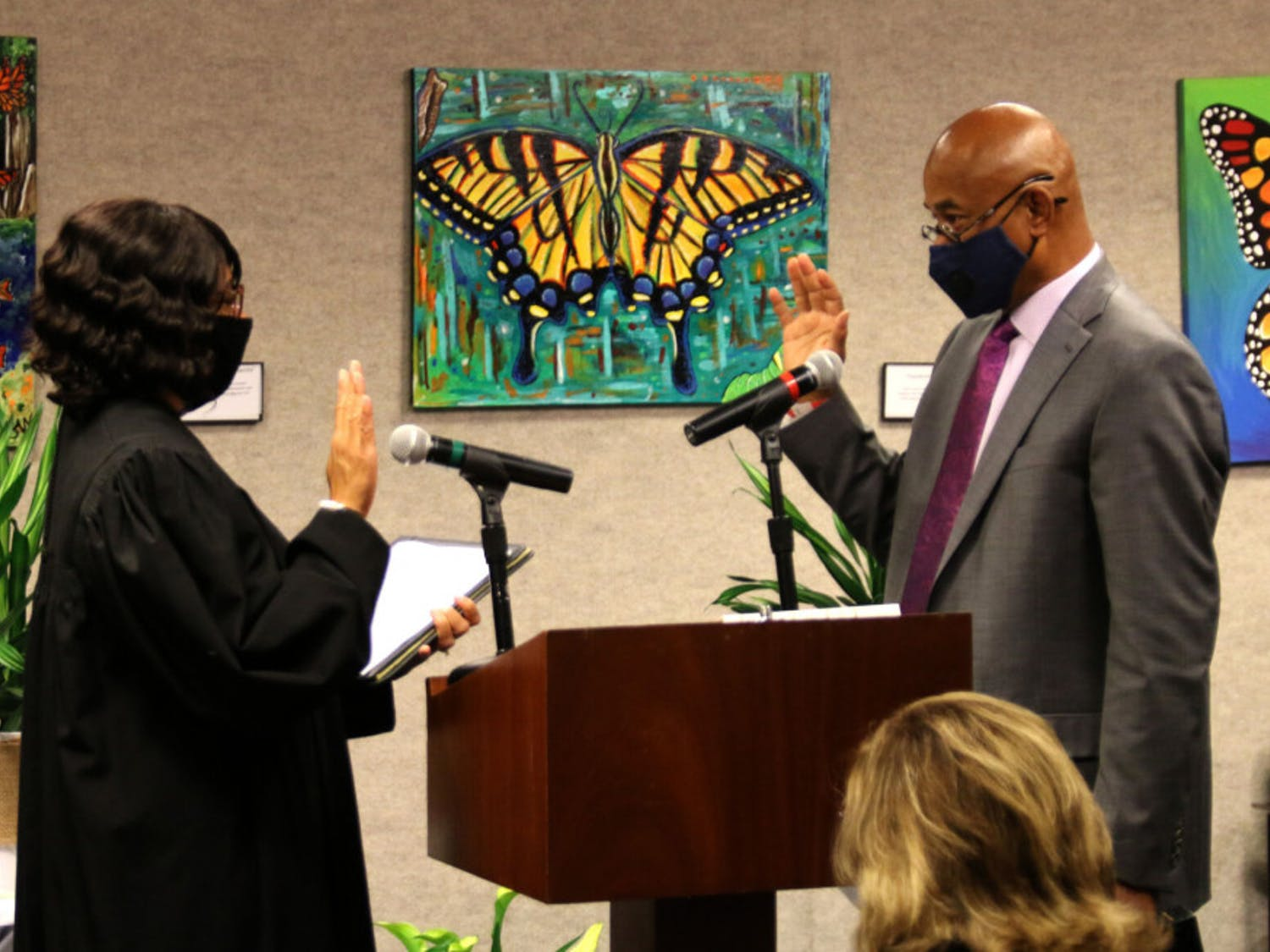 """Judge Meshon Rawls (left) swears in Charles Chestnut IV (right), for his third term as an Alachua County Commissioner, serving District 5, at the John R. """"Jack"""" Durrance Auditorium on Nov. 17, 2020."""