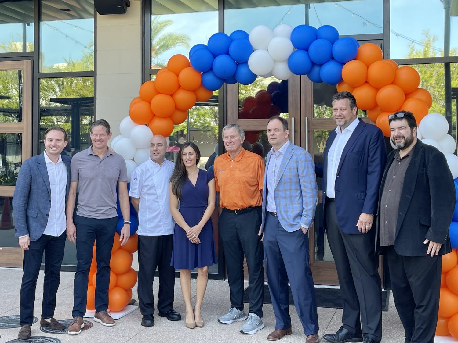 Legendary Gator football coach Steve Spurrier gathered with family and staff to celebrate the opening of Spurrier's Gridiron Grille. The restaurant, located at 4860 SW 31st Place, opened Aug. 11.