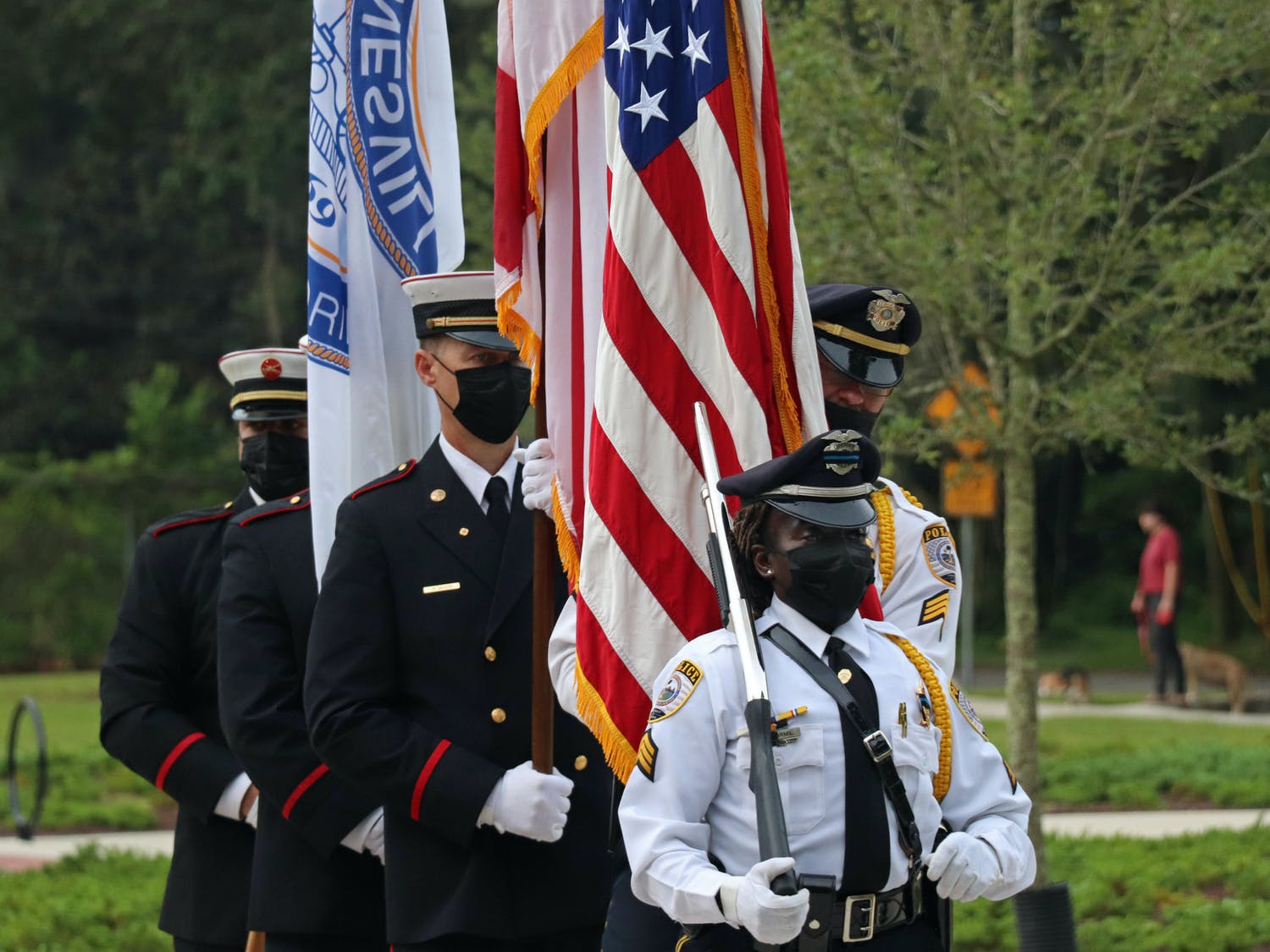 The Gainesville Fire Rescue and Gainesville Police Department joint honor guard does a presentation of colors at Reserve Park on Saturday, Sept. 11, 2021. The three flags represent the city, state and country (from left to right).