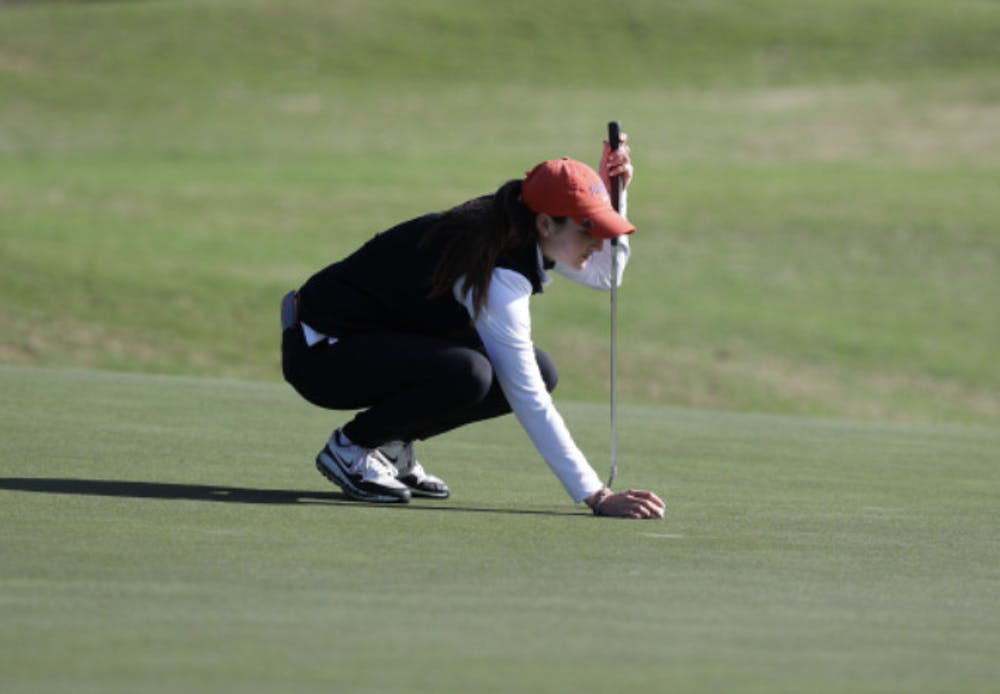 <p>Maisie Filler lines up a putt at the Gator Invitational in February. </p>