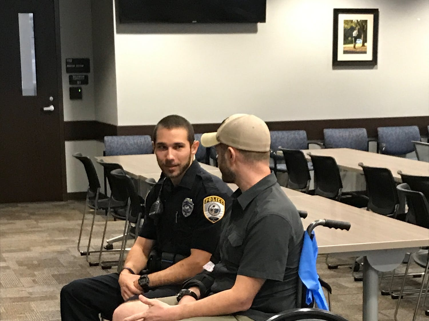 Joshua Roe, a 36-year-old UF doctoral student, and Gainesville Police officer Jack Salafrio meet on Thursday for the first time after Salafrio responded to a crash on Jan. 6 and rescued Roe. Roe was run over by his own car, which was stolen, police said.
