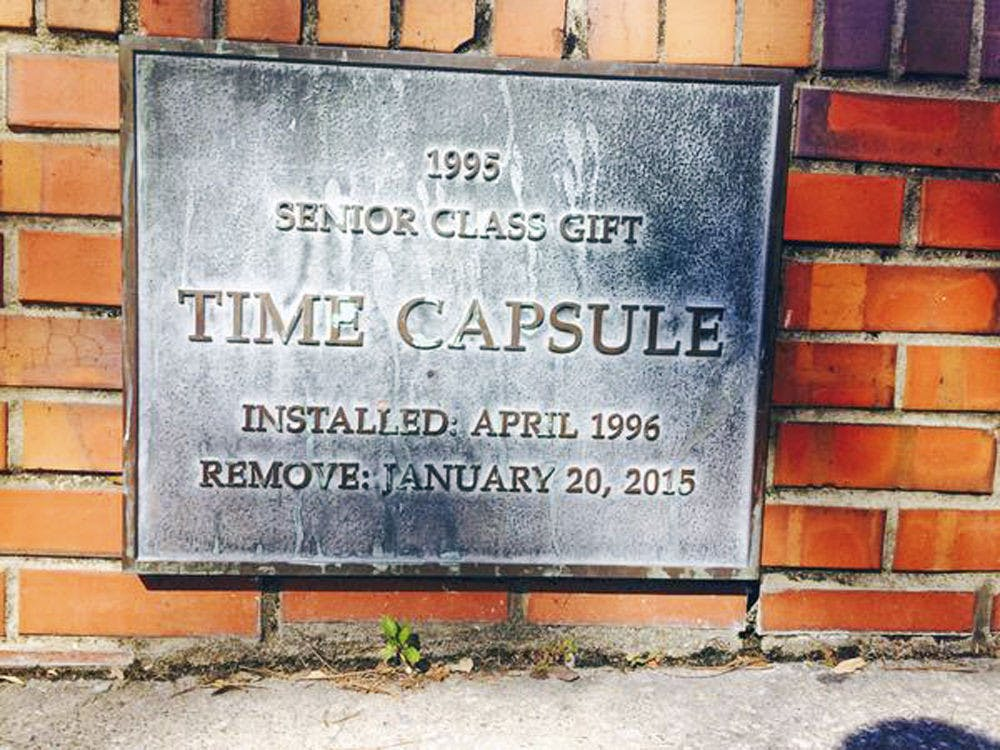 <p>A photo of the plaque covering the time capsule installed near the Florida Gym. The opening of the capsule was delayed until April to coincide with the UF Class of 1995's reunion.</p>