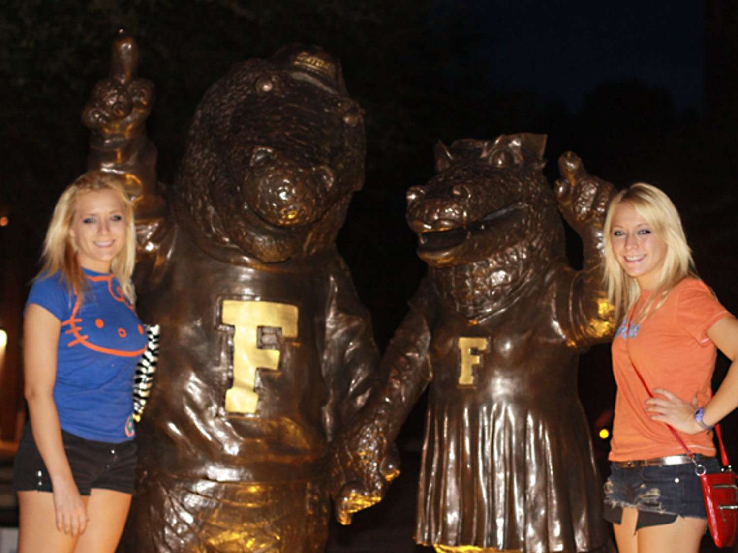 """Brittany and Erica Taltos pose for a photo in front of the Albert and Alberta statue on University Avenue. The twins, who are recognized for their appearance on season four of MTV's """"Jersey Shore,"""" are trying to auction a date with themselves on eBay."""