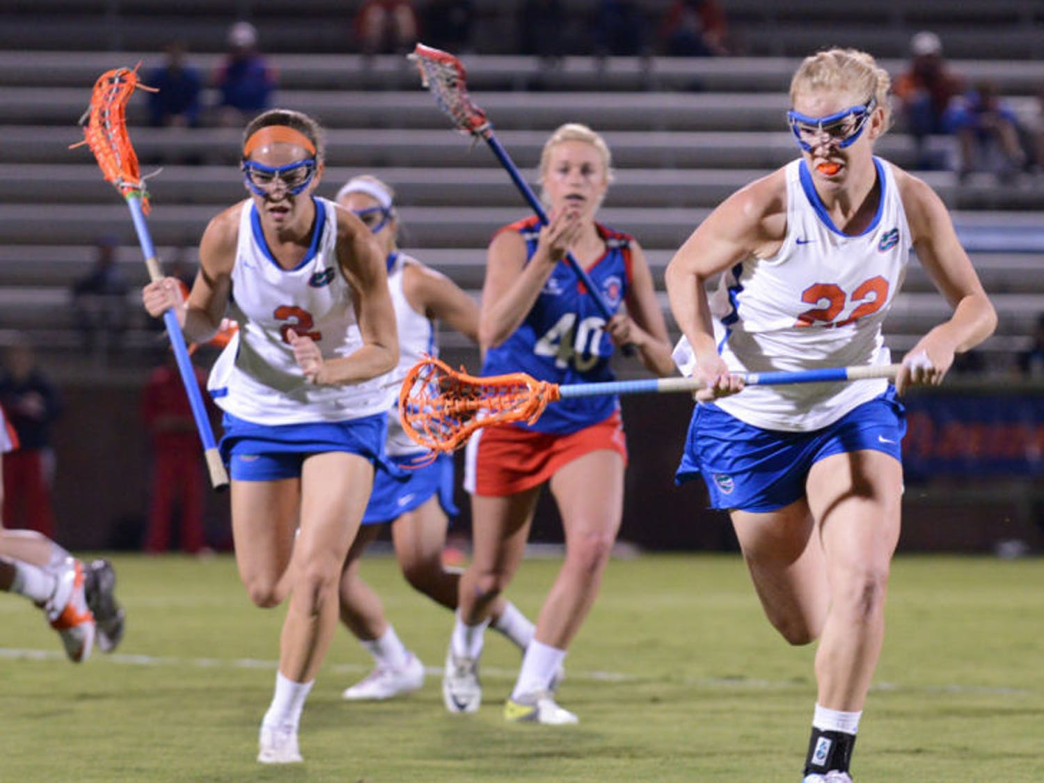 Senior Brittany Dashiell (22) runs after the ball during Florida's 18-13 exhibition win against England on Jan. 24 at Dizney Stadium. Dashiell became the first Gator to record 200 career draw controls on Saturday.