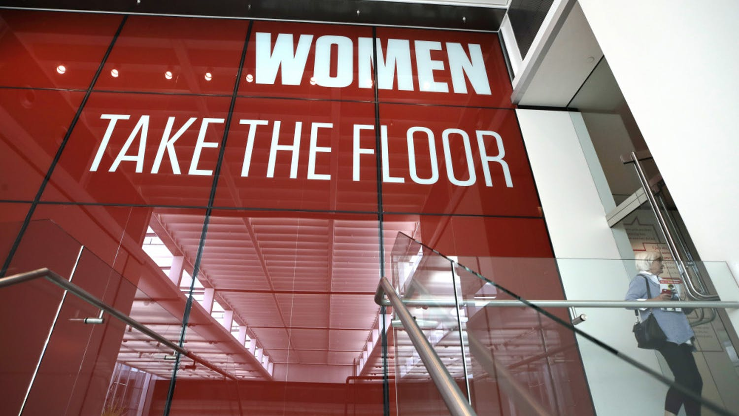 """In this Sept. 18, 2019, photo, a woman enters an exhibit at the Museum of Fine Arts in Boston. In the wake of a student group incident last spring when the world-class museum was accused of racism, the MFA has scrambled to make amends. It has created a new position, senior director of inclusion, in an effort to become a more deliberately diverse organization. In a nod to the need for greater gender equity, it has given over an entire wing to female artists in """"Women Take the Floor,"""" an exhibition timed to coincide with next year's centennial of U.S. women winning the right to vote. (AP Photo/Elise Amendola)"""