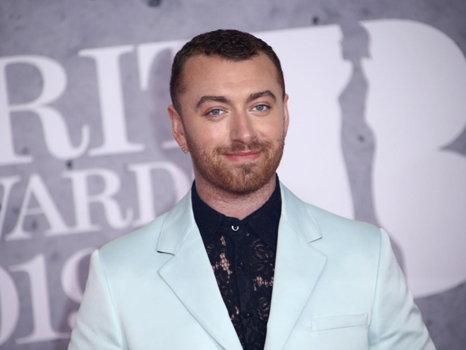 """This Feb. 20, 2019, file photo shows singer Sam Smith posing for photographers upon arrival at the Brit Awards in London. The Oscar-winning pop star has declared his pronouns """"they/them"""" on social media after coming out as non-binary in his """"lifetime of being at war with my gender."""" The English """"Too Good at Goodbyes"""" singer said Friday, Sept. 13, 2019, he's decided to """"embrace myself for who I am, inside and out ..."""" (Photo by Joel C Ryan/Invision/AP, File)"""