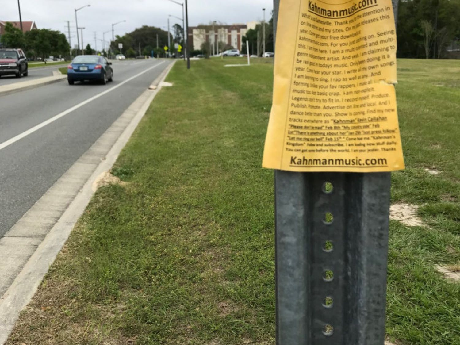 Callahan posted these yellow flyers at bus stops across Gainesville to promote his music.