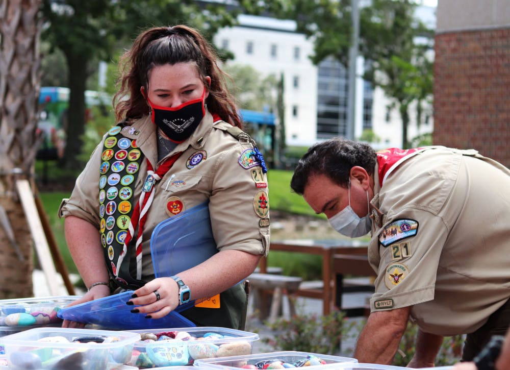 Scouts unpack healing stones to place in UF Health Children's Healing Garden