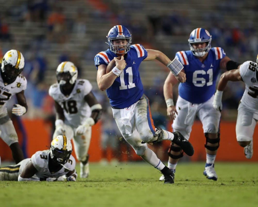 <p>Kyle Trask darts through Missouri defenders in Florida's game versus Missouri on Oct. 31. He and senior Kadarius Toney will lead the Gators in their charge against Georgia this weekend.</p>