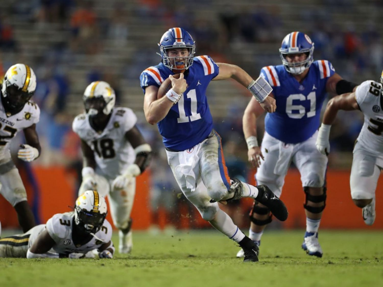 Kyle Trask darts through Missouri defenders in Florida's game versus Missouri on Oct. 31. He and senior Kadarius Toney will lead the Gators in their charge against Georgia this weekend.