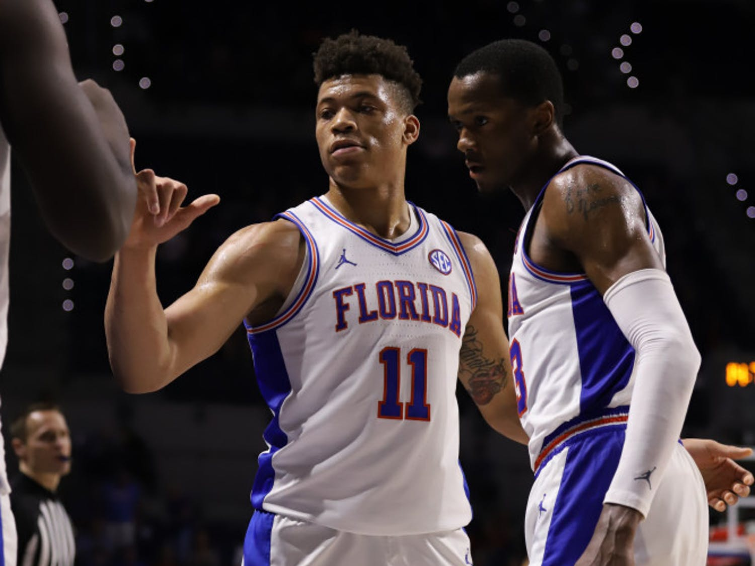 Junior Keyontae Johnson (left) and sophomore Scottie Lewis (right) at the Gators' game against Arkansas last season. They are among Florida's returning defensive leaders this season.