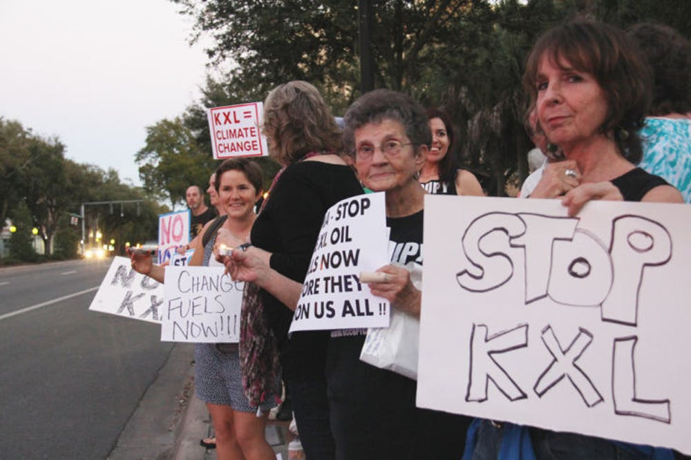 "<p class=""p1""><span class=""s1"">Members of the Gainesville community join together to call for President Barack Obama to stop the production of the Keystone XL Pipeline. The protest was held on Bo Diddley Community Plaza on Monday evening.</span></p>"