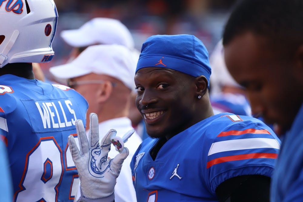 <p>Kadarius Toney holds his Joker-themed mouth guard in his right hand as he waves at the camera during Florida&#x27;s game against Vanderbilt on Nov. 9, 2019.</p>