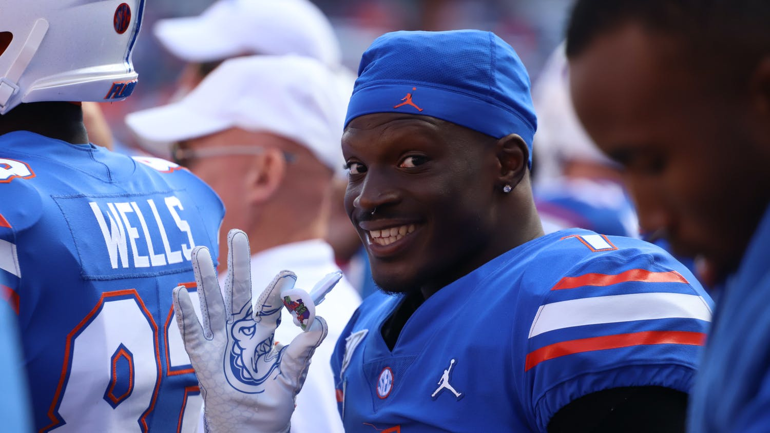 Kadarius Toney holds his Joker-themed mouth guard in his right hand as he waves at the camera during Florida's game against Vanderbilt on Nov. 9, 2019.
