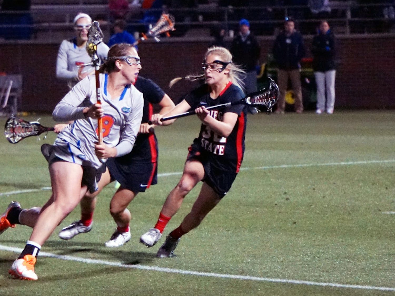 Shannon Gilroy runs toward the net during Florida's win against San Diego State at Donald R. Dizney Stadium.