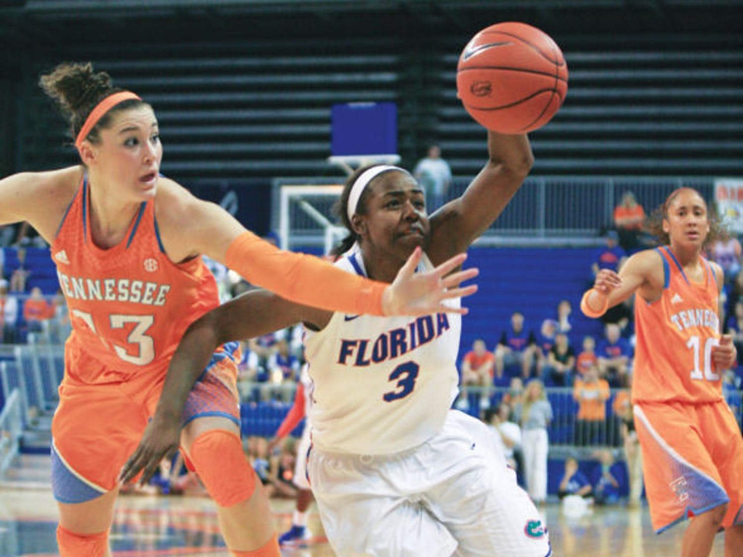 Guard January Miller (3) fights for possession with guard Taber Spani (13) during Florida's 78-75 overtime loss to Tennessee on Sunday in the O'Connell Center.