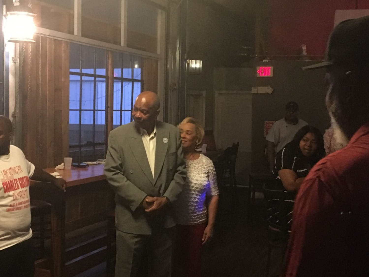 District 1 Commissioner Charles Goston stands surrounded by supporters after conceding the runoff election between him and Gigi Simmons.