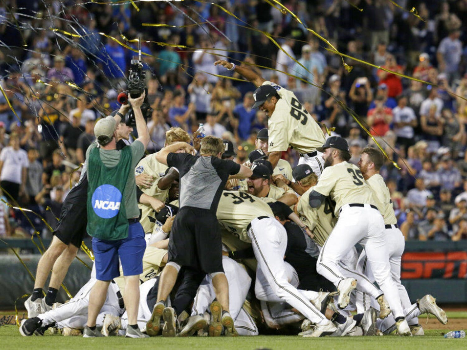 FILE - In this June 26, 2019, file photo, Vanderbilt players celebrate winning Game 3 and the champinship of the NCAA College World Series baseball finals against Michigan in Omaha, Neb. If not for the coronavirus pandemic, there would have been a World Series championship series Omaha, Nebraska. (AP Photo/Nati Harnik, File)