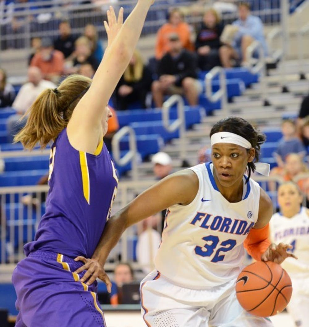 <p>Senior forward Jennifer George dribbles in the lane during Florida's 77-72 win against LSU in the O'Connell Center.&nbsp;</p>