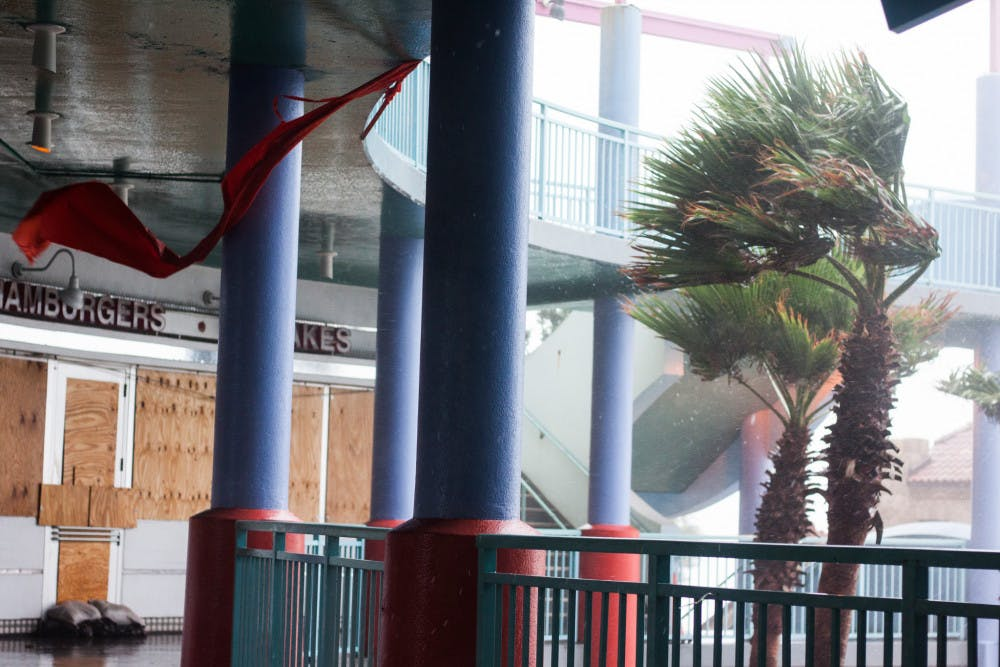 """<p dir=""""ltr"""">Part of an awning gets blown away at Ocean Walk Shoppes, an open-air shopping mall in Daytona Beach, as Hurricane Matthew makes its way through the area on Friday. The eye of Hurricane Matthew was, at one point, about 10 miles off the coast of Daytona Beach.</p><p><span></span></p>"""