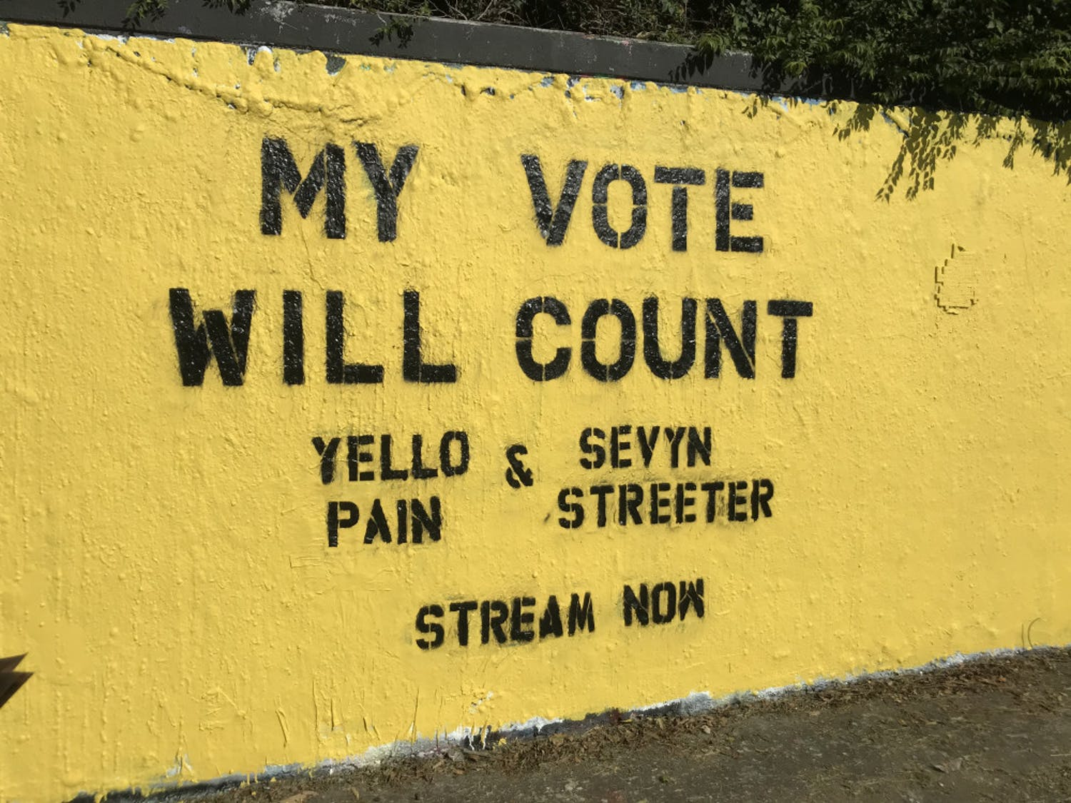 "In honor of Yellopain's song, Danielle Gray, a marketing rep for the record label AWAL, and her friend painted ""My Vote Will Count"" on 34th street with a sunny yellow background, the same shade as his hair. When Kindred saw the mural, he said he almost cried."