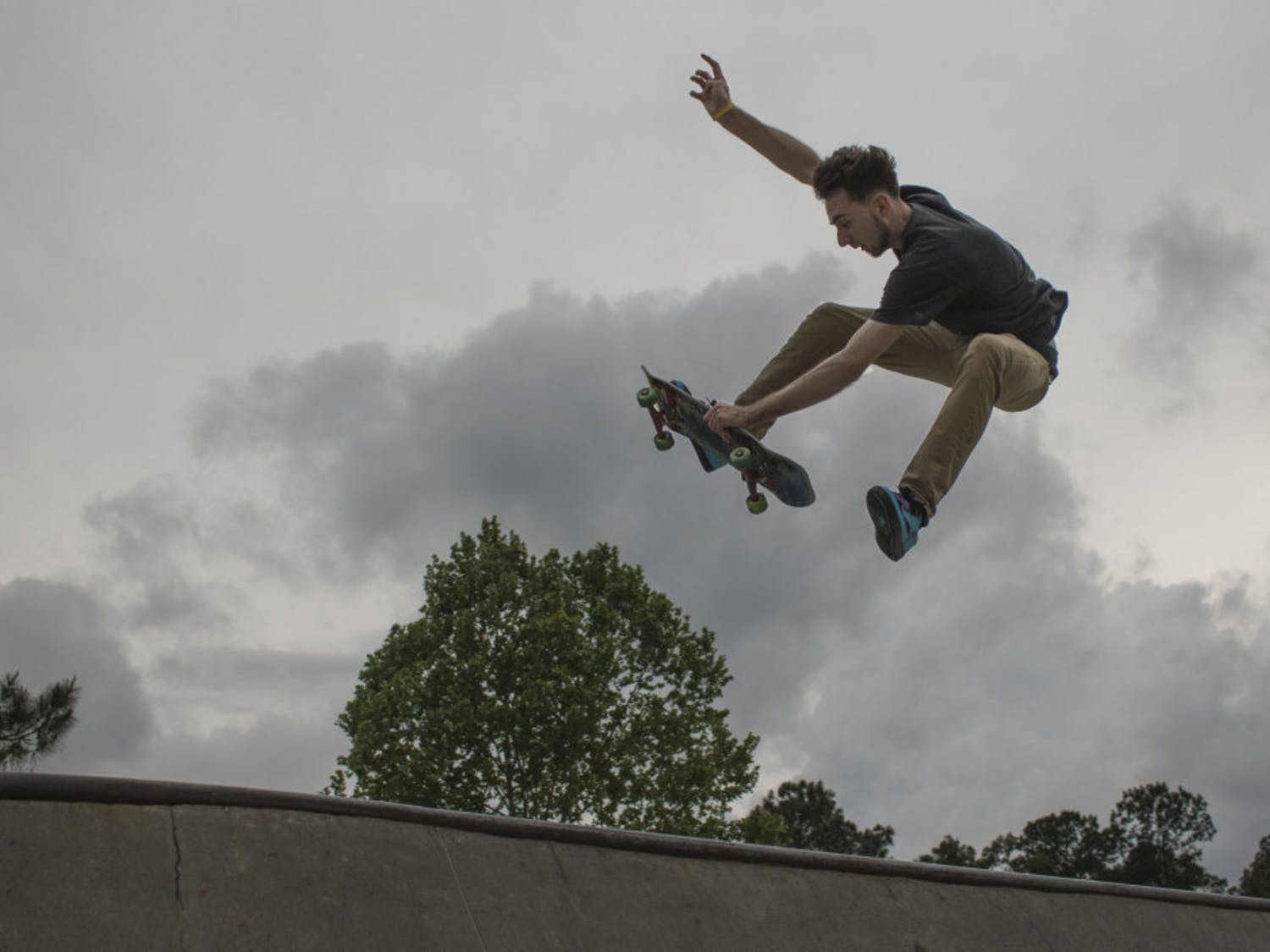 """Paul Austin, a 21-year-old UF veterinary medicine student, performs a trick on his skateboard Tuesday evening at Possum Creek Park, 4009 NW 53rd Ave. Austin works full time as the head assembly technician specialist at Fabco-Air, Inc. and takes all of his classes online, but he said he tries to practice skating at least two or three times per week. """"It's my way to get out and be free,"""" Austin said. """"It's like flying to me."""""""